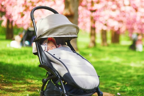 baby in a pushchair - If you're expecting your first baby, you might be wondering what's the difference between a pram and a stroller. Here we'll uncover the main differences and discover why you'll probably need both - eventually.