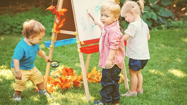 three toddlers playing outside - summer activities for toddlers