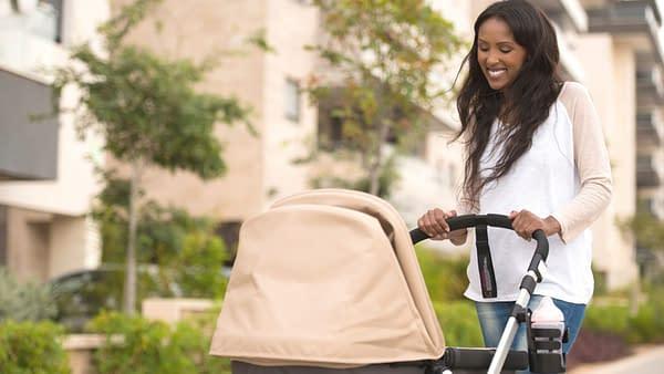 Woman pushing baby in pram