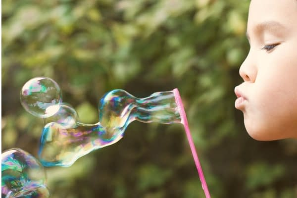 Summer activities for toddlers - blowing bubbles