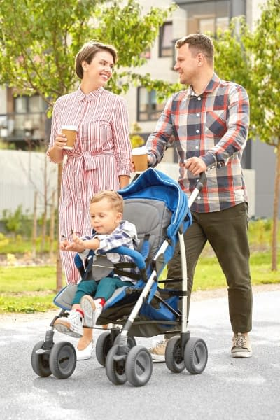 Kid in a stroller - If you're expecting your first baby, you might be wondering what's the difference between a pram and a stroller. Here we'll uncover the main differences and discover why you'll probably need both - eventually.
